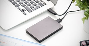 computer being backed up to an external hard drive